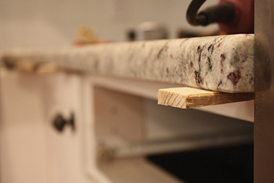 Use wood shims between the cabinet base and conutertop to ensure level.