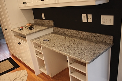 The countertops are held in place by weight, friction and beads of silicone sealant.