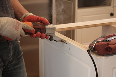 Here an installer notched a cabinet base for a countertop support.