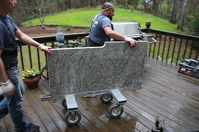 Once on location, the installers use wheeled carts to move the heavy slabs around the site.