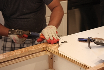 In some cases, a countertop may have been fastened to the cabinet base prior to having the finished surface installed.
