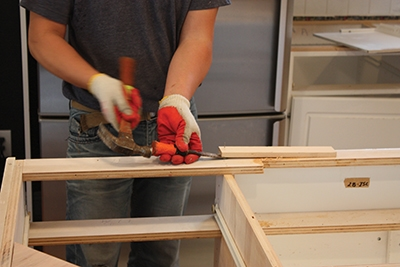 Pry off any old wood blocks or shims from the top of the cabinet base.