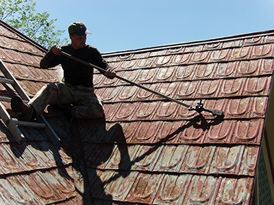 This terne metal roof had hips and valleys that complicated the project.