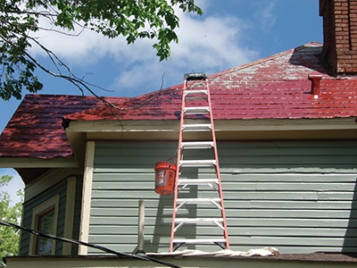 When possible, paint from a ladder rather than climbing atop the roof.