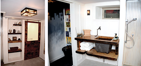 A sink vanity and shelving made of reclaimed lumber maintained the rustic decor of the man-cave bathroom.