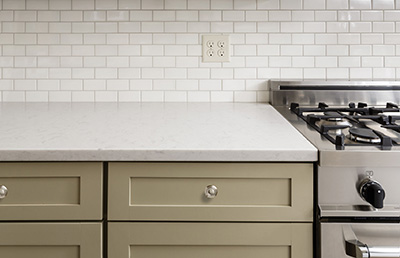 28673953 - kitchen counter with subway tile, stainless steel oven stove, shaker cabinets