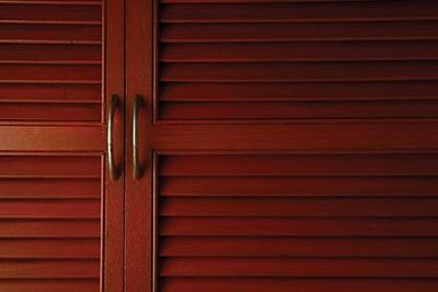 39907879 - wooden cabinet door with metal handle