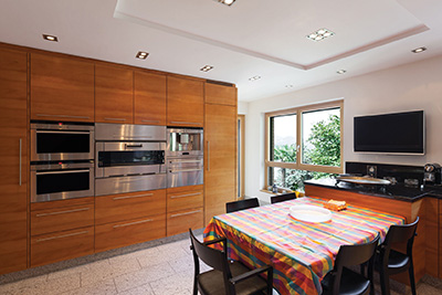 46269296 - interior of a modern apartment, wide domestic kitchen, cabinet with appliances