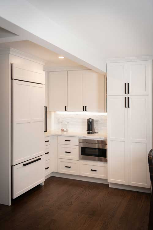 White Shaker stock cabinets that look custom