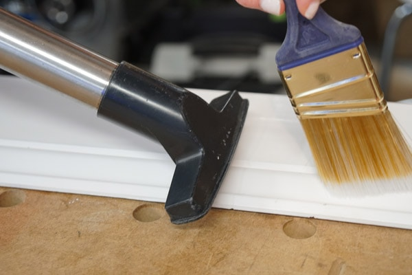 vacuuming trim surface before painting will help the paint lay flat and smooth
