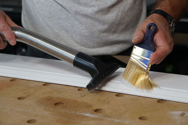 cleaning surface using dry paint brush and vacuum to help eliminate brush strokes of new paint job