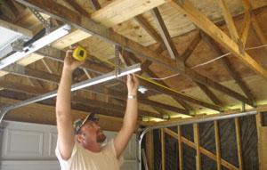 Open sesame install a garage door extreme how to for Garage door horizontal track