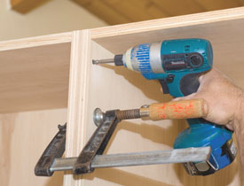 Cabinets can be configured side by side. We used clamps to hold the faces flush while screwing the cabinets together.