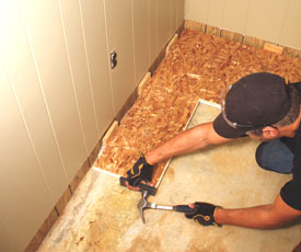Begin every other row of subflooring with a partial panel to stagger the joints.