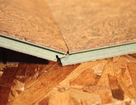 The tongue-and-groove joints of the cork floor connect easily.
