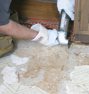 "The Rockwell multi-purpose vibrating tool was used to cut through the vinyl and 1/4"" plywood subfloor around the edges of the kitchen cabinets."