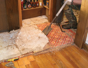 Then, a roofer's tear-off tool made quick work of removing the old flooring.