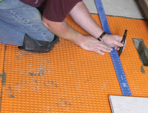 Lay out the floor tile.