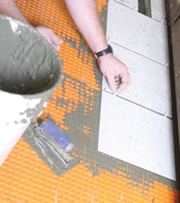 Tile is set in the same manner as for other underlayments, except the thinset mortar is mixed a little thinner.