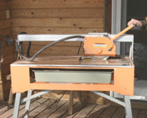 A Chicago Electric Power Tools Bridge Tile Saw, from Harbor Freight Tools, makes quick and easy work of cutting the large floor tiles.
