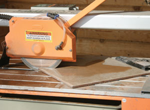 The tile is securely held in place on the table, and the wet-saw is pulled through the tile. Even 45-degree or other angled cuts are easy and precise.