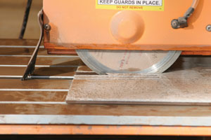 Cutting notches is fast with a bridge-type tile saw.