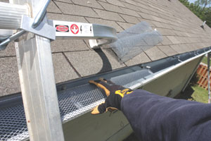 Gutter covers prevent debris accumulation that can lead to ice dams during winter.