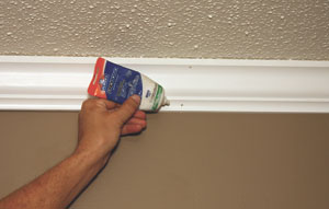 Finish by caulking, filling nail holes, finish-sanding and adding touch-up paint.