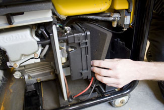 The daily inspection of the unit should include checking the air filter and cleaning if necessary.