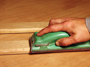 Sand the moulding smooth before applying a wood stain.