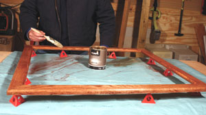 When applying varnish to the frame, Painter's Pyramids elevated the frame for easy access to the edges.