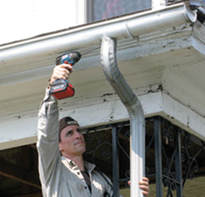 Half-round gutters are not only a nice touch on an old house, but they work better than ogee profiled gutters. Get them from a roofing supply house.