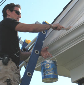 Paint with a semi-gloss exterior paint.