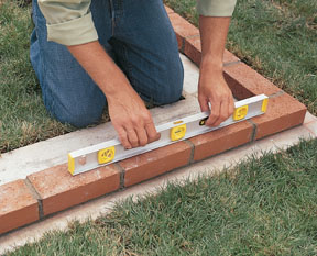 You May Choose To Minimize Cutting By Moving One Wall Over An Inch Or Two.  With A Pencil, Mark The Footing For The Centers Of Each Joint.