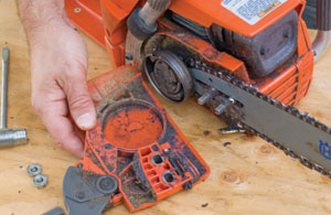 Chainsaw rx extreme how to remove the cover which on the husqvarna includes the chain brake assembly note the buildup of sawdust and oil greentooth Image collections