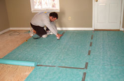 Installing A Laminate Floor Extreme How To - How to install moisture barrier under laminate flooring