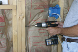 Demonstrating a drill going through multiple pieces of wood