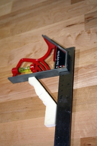 Measure the angle of the crown moulding to determine the size of the mounting blocks that will be installed behind the trim.