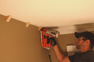 Nail the blocks into the wall studs.