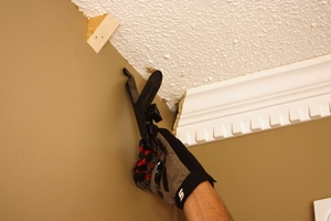 If you don't have an assistant, Crown Hangers provide a handy way to position the moulding while you fasten it in place.