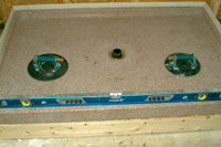 Fig%2012%20Check pan level Install a Solid Surface Shower Pan