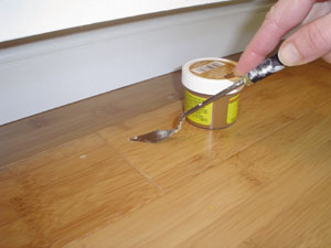 The beauty of bamboo flooring extreme how to for Wood floor hole filler